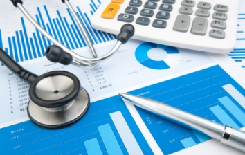 Stethoscope with financial statement, calculator, pen